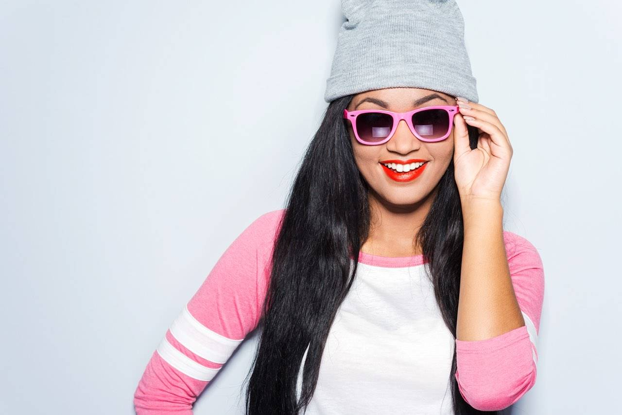 asian hip girl with sunglasses and hat