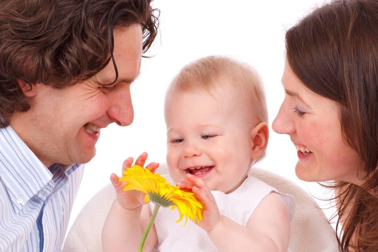 family caucasian flower mom dad baby