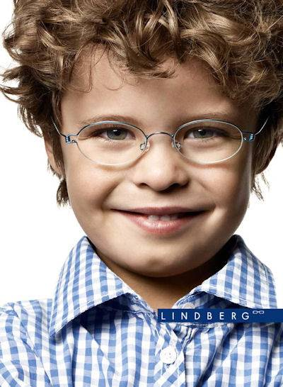 young boy wearing designer frames