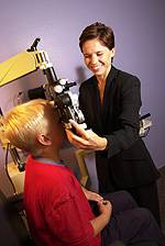 eye doctor with child patient at margolies family eye care in levittown PA