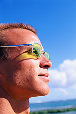 Lens Treatments In Laurel Springs, NJ | man wearing glasses in the sun