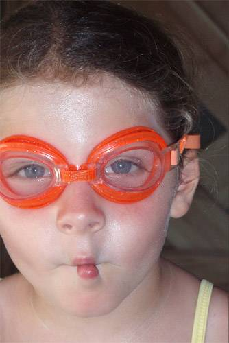 Childl wearing prescription goggles