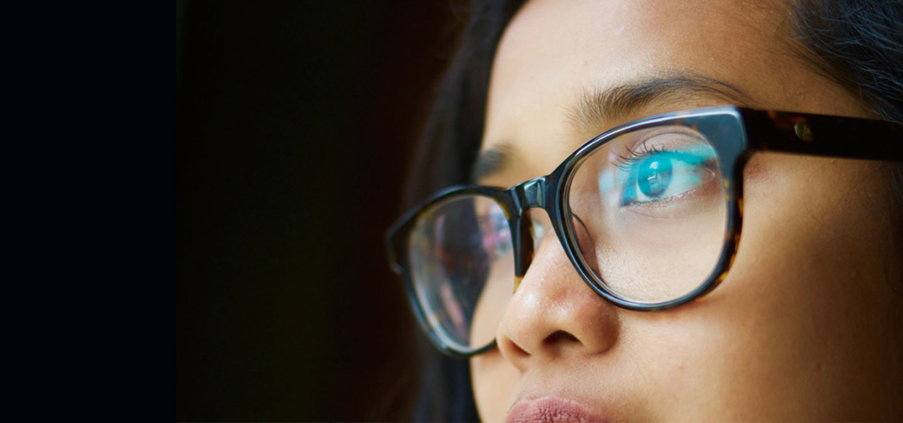 asian glasses 20s woman staring
