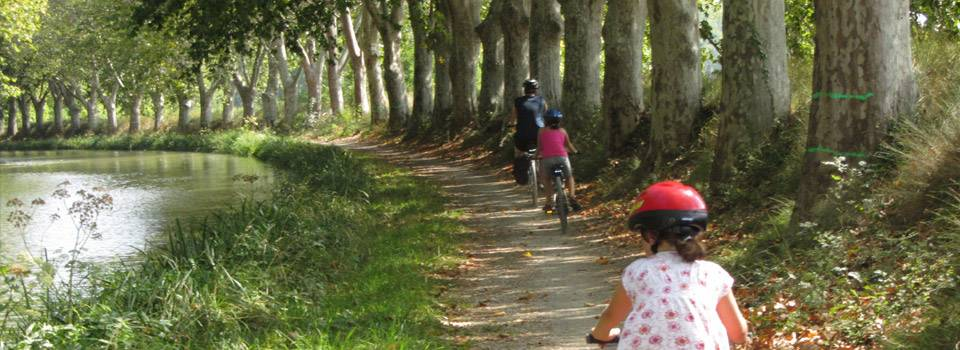 family riding bikes along path