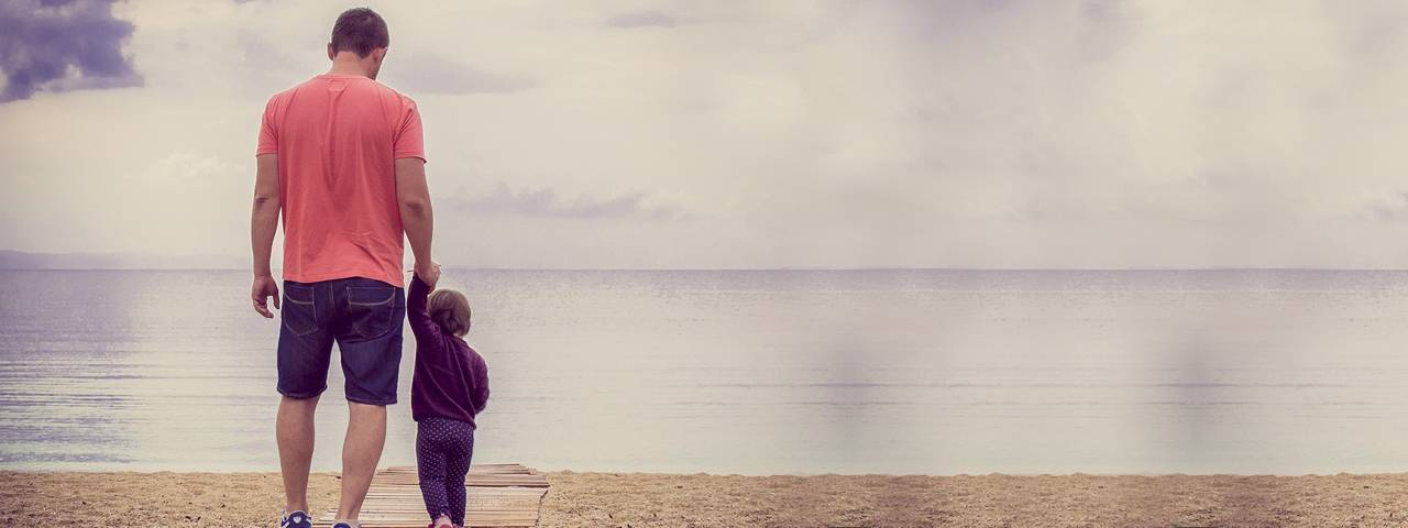 father_daughter_walking_beach_1280x480
