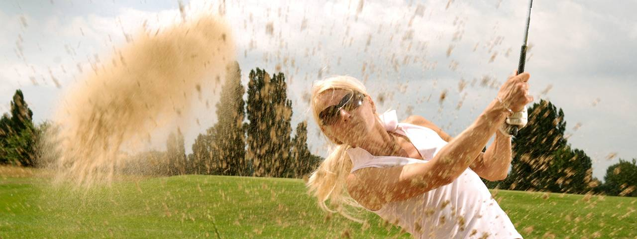 sports golfing caucasian woman sunglasses